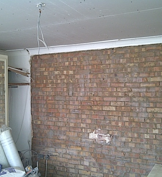 Blown plaster is removed and wall is PVAed