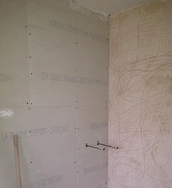 Aqua board is fitted onto to studwall