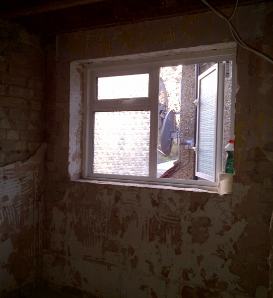 Existing bathroom suite and tiles removed